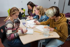 Students doing art